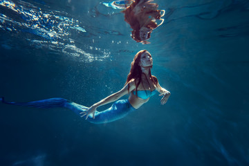 Freediver girl with mermaid tale