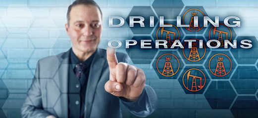 Smiling Industrialist Pushing DRILLING OPERATIONS