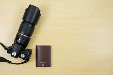 Digital camera and passport on table for travel