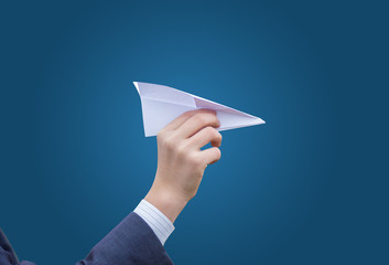Business man throws a paper plane. Concept of transfer of commun