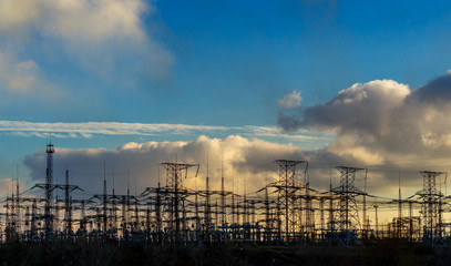 High voltage switchgear equipment small clouds at sunset.