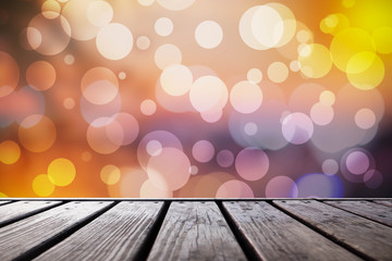 wood table in front of glitter silver and gold bright bokeh ligh
