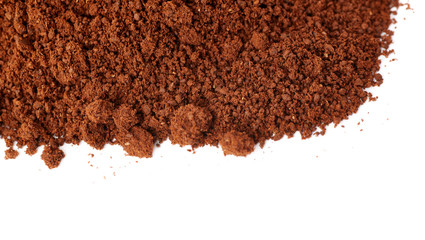 Ground milled coffee powder isolated over white background
