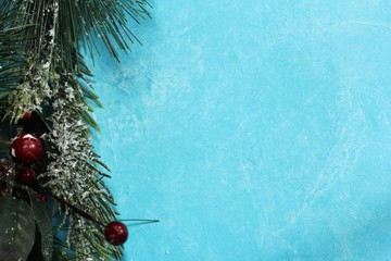 Xmas granland background on blue background with free space