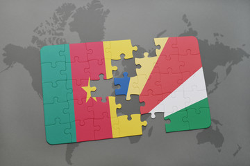 puzzle with the national flag of cameroon and seychelles on a world map.