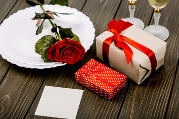 Little present boxes with red ribbons lie before white plate wit