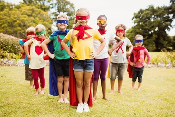 Children wearing superhero costume standing