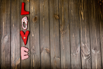 Cloth lettering 'I love you' lies on wooden dinner table