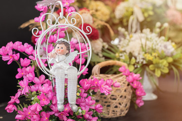 Clay Doll decorated with colorful flowers background.