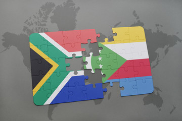 puzzle with the national flag of south africa and comoros on a world map.