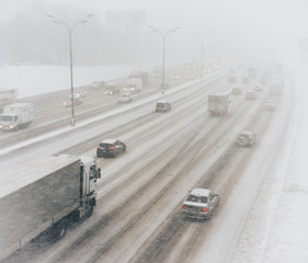 snow-covered road, cars, winter