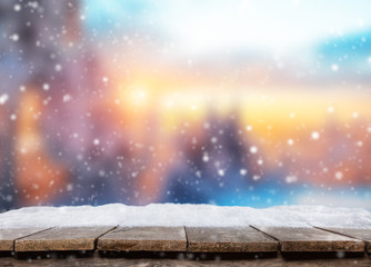 Empty wooden planks with abstract winter background