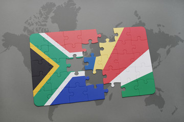 puzzle with the national flag of south africa and seychelles on a world map.