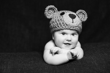 cute baby wearing knit bear hat with suspicious expression