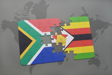 puzzle with the national flag of south africa and zimbabwe on a world map.