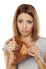 sad woman shows her empty wallet