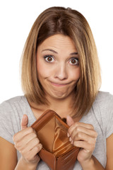 funny woman shows her empty wallet