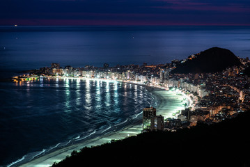 Wall Mural - View of brightly illuminated Copacabana beach in Rio de Janeiro at night