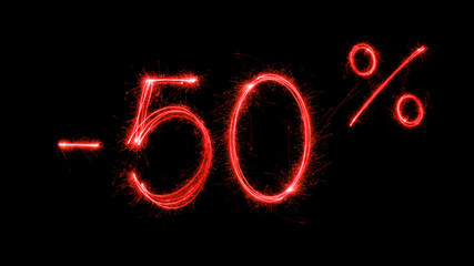 Hot sale 50 % off  - made with red sparklers on black background.