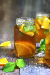 Orange iced tea in a glass jar.