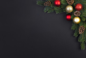 Christmas tree with decorations on a black background