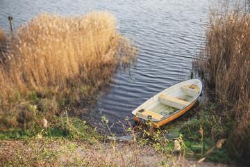 Yellow fishing boat in a dark lake