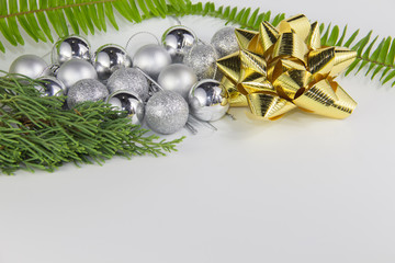 Golden Ribbon and Christmas ball on white background