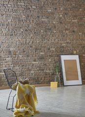 brick wall decoration with black chair and frame