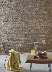 brown brick wall and yellow wrap with wooden table