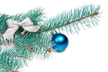 Branch fir from silvery bow and blue ball isolated on white