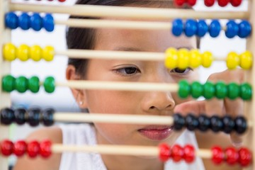 Close-up of girl playing with abacus