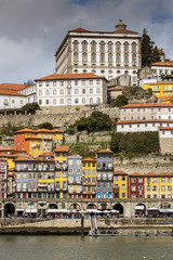 View over the colorful buildings of Ribeira district and Episcopal Palace, Porto, Portugal
