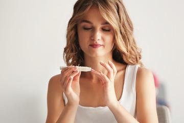 Woman using lancelet on finger