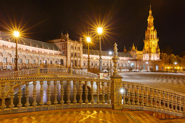 Fototapete - Patterned fence of the bridge on the Spain Square or Plaza de Espana in Seville at night, Andalusia, Spain