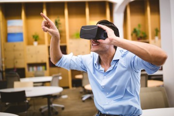 Young executive enjoying augmented reality headset at office