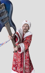 young man in the image of Santa Claus with a guitar in his hands