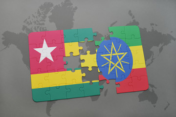 puzzle with the national flag of togo and ethiopia on a world map