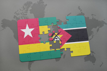 puzzle with the national flag of togo and mozambique on a world map