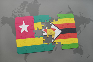 puzzle with the national flag of togo and zimbabwe on a world map