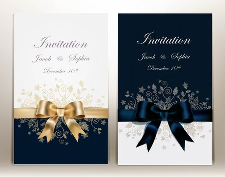 two pretty wedding invitation with ribbon and bow.