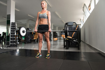 Woman Doing Heavy Weight Exercise For Back