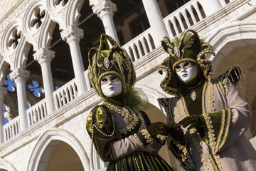Masks during Venice Carnival in St. Marco Square, Venice, Italy