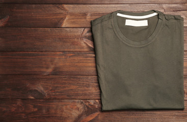 Blank color t-shirt on wooden background