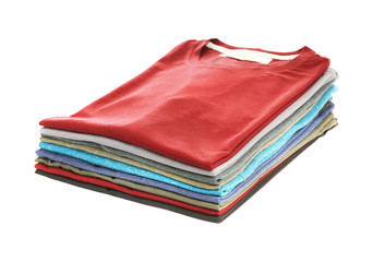 Stack of colorful t-shirts on white background