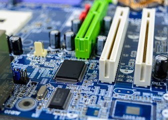 Computer motherboard with electronic component detail background