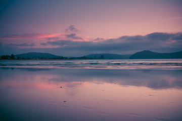 Pink and blue reflections of sunrise