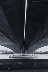 large concrete bridge construction vintage color tone,Shade shadow and light black and white photography concept.