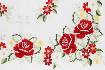 White cotton fabric in embroidery rose pattern for background or