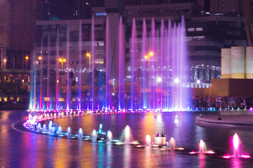 Beautiful blue and violet fountain in the night