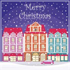 Christmas greeting card with a picture of snow-covered streets of the old town.